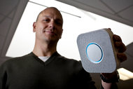 Tony Fadell, the chief executive of Nest, with his company's Protect smoke alarm.