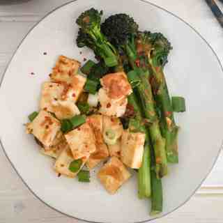 Dry Fried Tofu with Broccolini and Thai Peanut Sauce.  A vegan entree rich in plant-based protein and fiber from The Grateful Grazer.