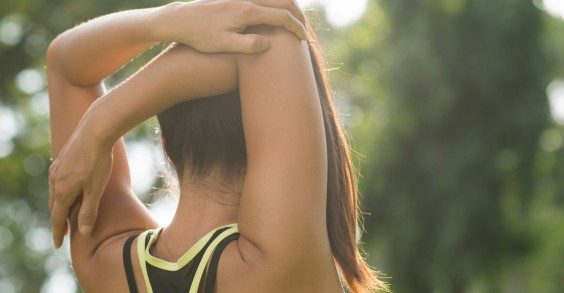 Woman Stretching Arm Overhead