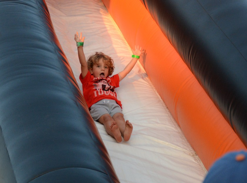 A little boy enjoys the bouncy slide at the Ducks game Wednesday night. Photo by Jamie Molnar