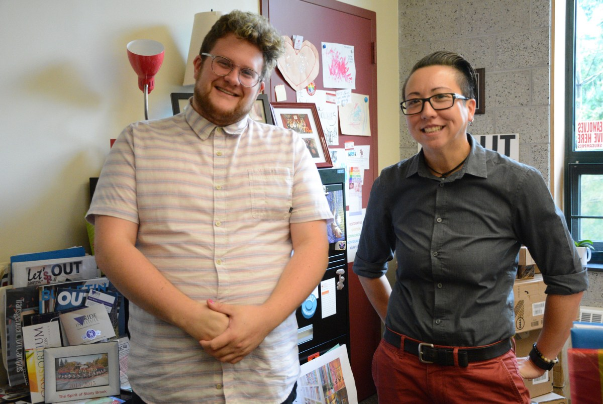 Graduate Assistant Jxhn Martin, left, and Coordinator of LGBTQ* Services Chris Tanaka in her office. Photo by Michelle D'Alessandro.