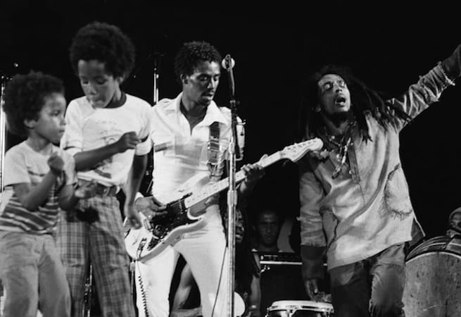 Ziggy Marley dancing onstage with Bob Marley