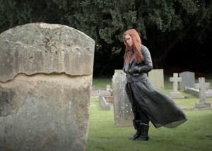 Terri standing in graveyard