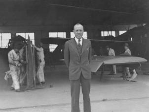 William Langhorne Bond at Shanghai's Lunghwa Airport, in front of a Loening