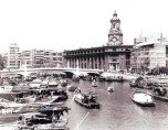 Not technically the Bund, but close: the Shanghai Post Office with CNAC sign on its clock tower, middle 1930s