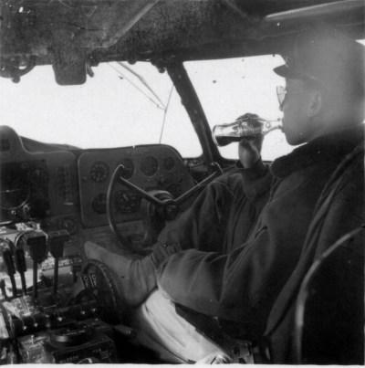 Bing Zhou enjoying a coke in the cockpit, late 1940s