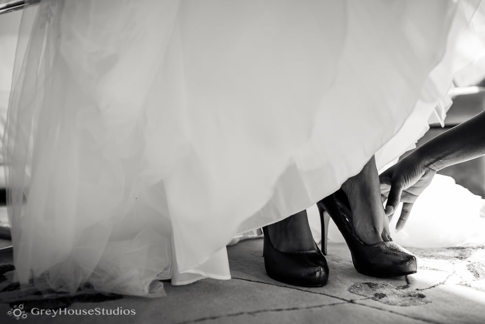 nyc east village wedding photos bride putting on shoes