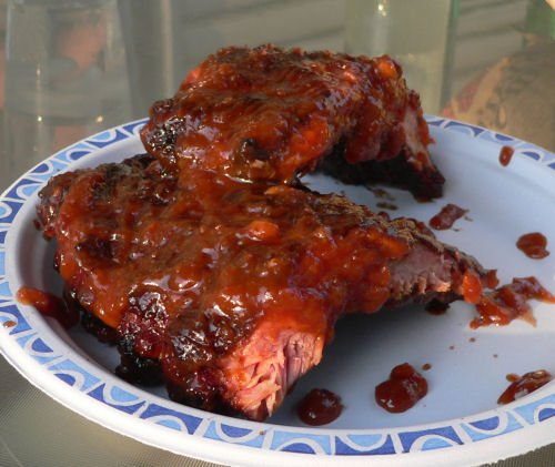 homemade barbeque ribs smoked on a charcoal grill