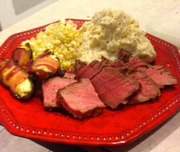 Monster Porterhouse Steak Cut Off The Bone and Plated with Seasonal Corn and Garden Potato's