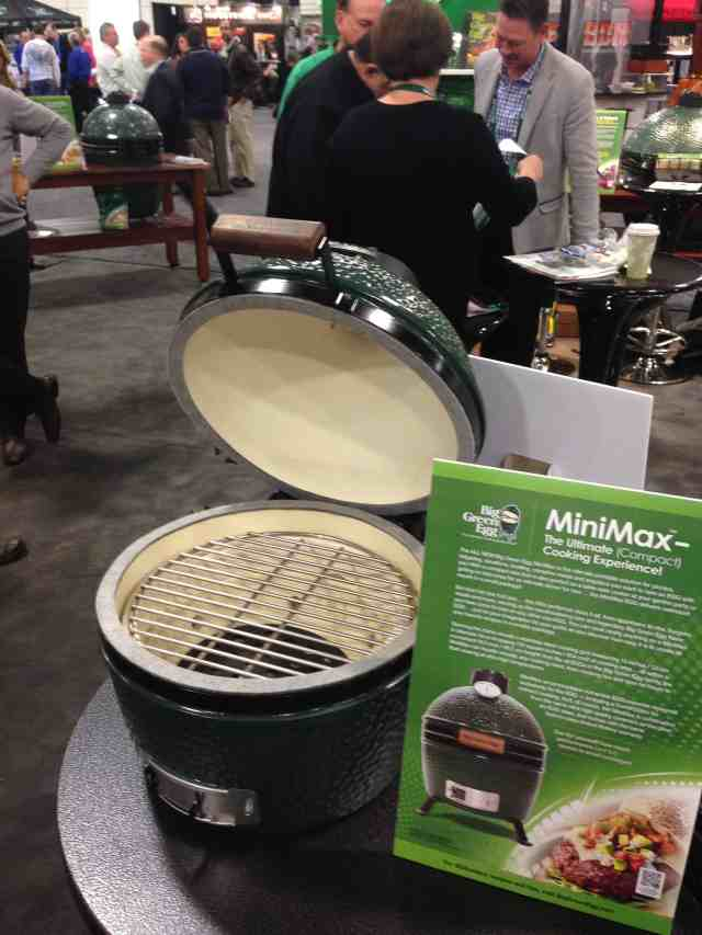 Big Green Egg has announced today the release of the newest offering to it's quiver of cookers. It is called the Mini-Max and it was unveiled today at the Hearth, Patio, and Barbecue Expo in Salt Lake City, UT. For the habitual Big Green Egg enthusiast, one look at the Mini-Max and you can tell some serious thought and work went into this one. The first thing you notice from the exterior is that the thermometer is about twice as large as the thermometers on the current Big Green Egg offerings. A gentleman pointed out to me that his eyesight is not quite as spry as it once was and he already finds the larger thermometer easier to read. When you open the Mini-Max, it has the same cooking area as the Small Big Green Egg, 13 inches in diameter. But what is noticeably different is that the bottom fire grate on the Mini-Max measures 10.5 inches across. In comparison, the bottom fire grate on the Small Big Green Egg measures in about half that size at 5.5 inches. This means more air flow for the Mini-Max and more control over what you are cooking!
