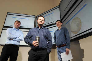 Georgia Tech Research Institute (GTRI) cyber-security specialists Ryan Spanier, Christopher Smoak, and Bryan Massey (l-r) pose in facilities used to gather information on the activities of hackers and pending cyber attacks. GTRI has developed a new open source intelligence gathering system known as BlackForest. (Credit: Gary Meek)