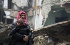 Photos of the week: Civilians evacuate Aleppo, Kuwait's new parliament, UK's Boris Johnson in Saudi