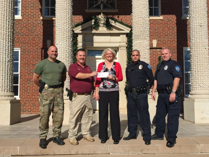 The Dominion House makes donation to Christmas with a Cop program