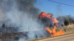 Fire departments battled large grass fire on the ground and in the air