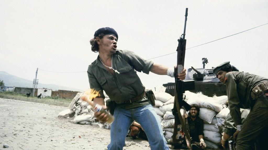 Susan Meiselas, Sandinistas at the walls of the Estelí National Guard headquarters: 'Molotov Man', Estelí, Nicaragua, July 16th, 1979 (1979)