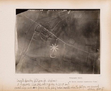 "Edward Steichen, ""Concrete landing platform for airplanes at Puxieux (each strip about 50 ft. wide by 250 ft long), crescent shape mass was formed by the pile of broken concrete when the platform was removed, altitude 15,000 ft."""