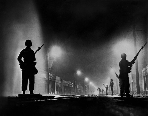 John Malmin. Aug. 13, 1965: National Guard troops secure a stretch of 103rd Street, dubbed Charcoal Alley, in Watts to help Los Angeles authorities restore order. This image is looking east from Compton Avenue.