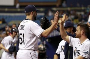 Nate Karns is congratulated by teammates as he returns to the dugout during the 8th inning of a game against the Texas Rangers at Tropicana Field on May 8, 2015 (Kim Klement/USA Today Sports)