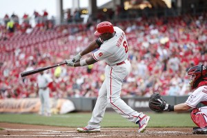 Ryan Howard lines an RBI double during the first inning of a game against the Cincinnati Reds at Great American Ball Park on June 8, 2015 (Joe Robbins/Getty Images)