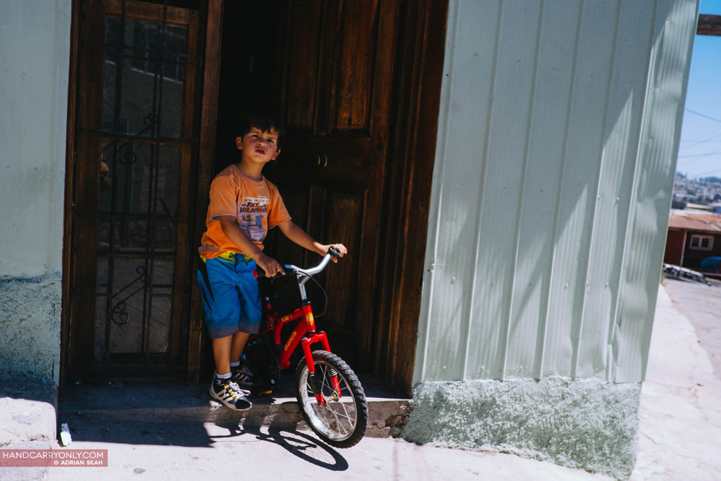 boy with bike valparaiso chile