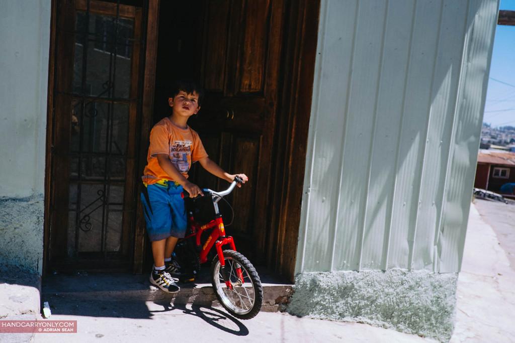 boy with bike valparaiso chile