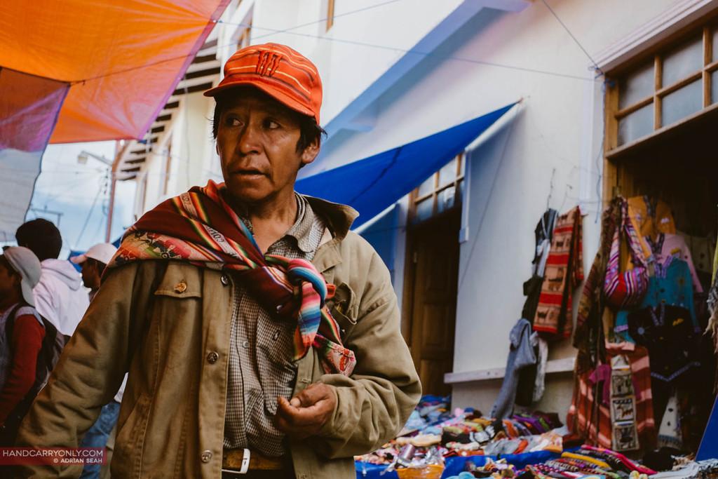 man carrying goods bolivia