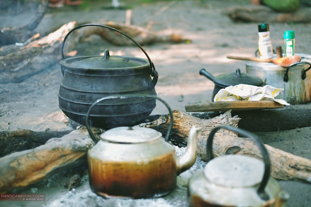 kettles and pot on wood fire