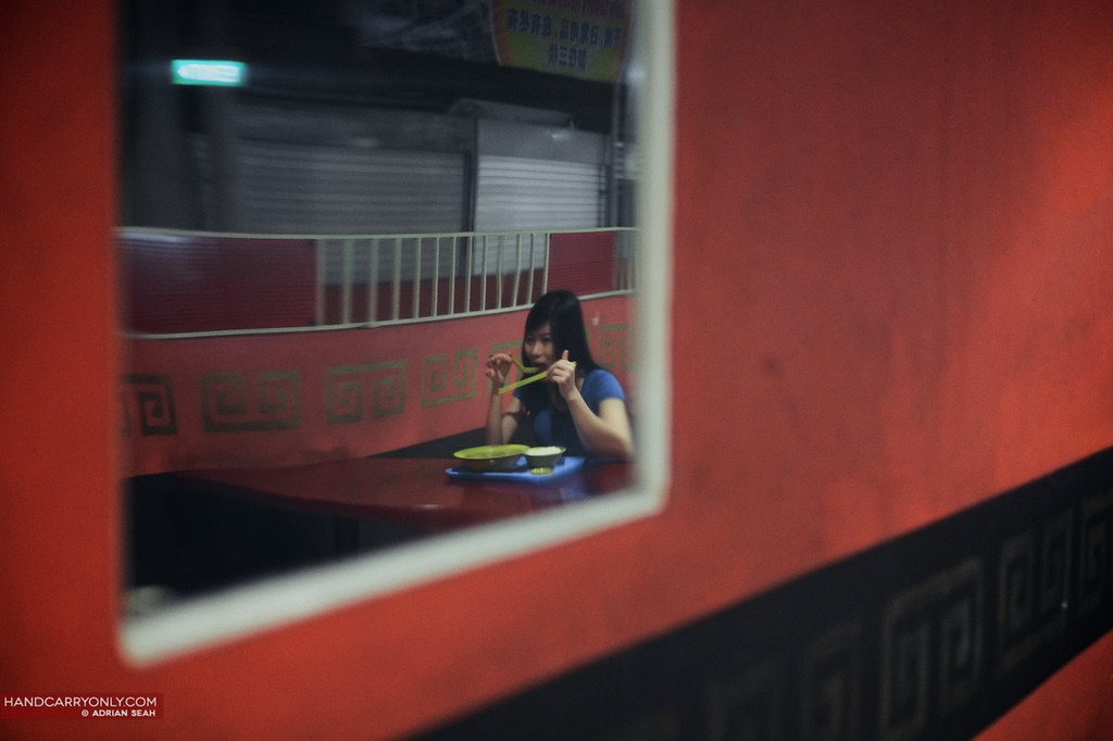 girl having dinner alone reflection