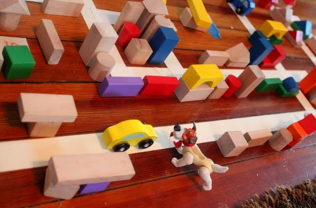 preschooler building a city with blocks