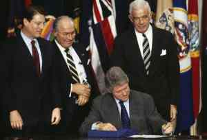 Bill Clinton signing into law the North American Free Trade Agreement