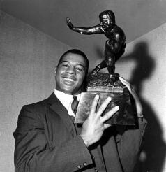 Ernie Davis becomes the first African American to win the Heisman Trophy