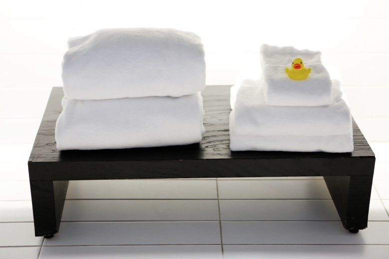 spa towels on table with rubber duck