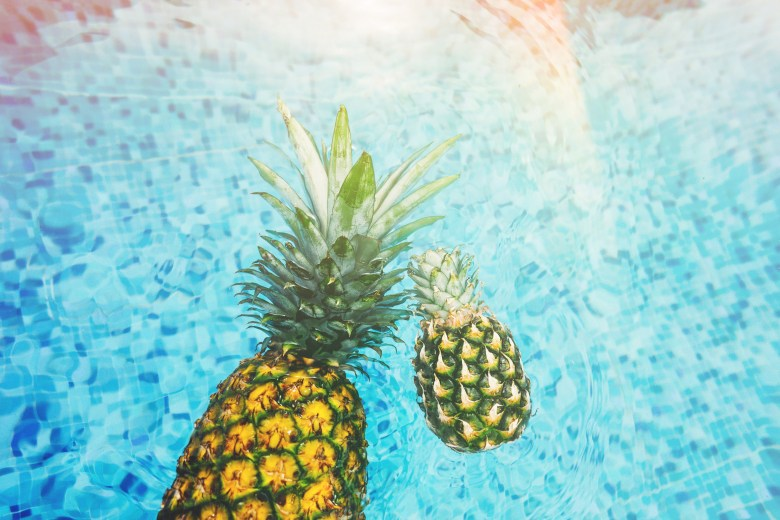 pinapples floating in pool
