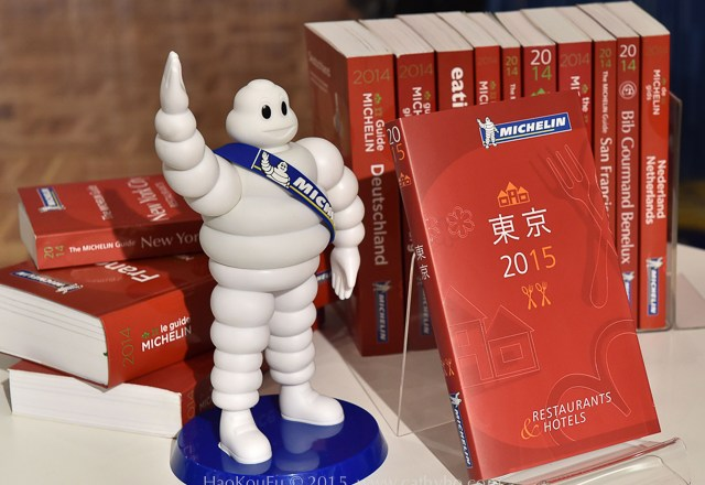 "The new Michelin Guide Tokyo 2015 guidebook is displayed during the publication announcement ceremony in Tokyo on December 02, 2014. Michelin guide announced the 12 three-star restaurants, 53 two-sar restaurants and 161 one-star resurarants being selected in the 2015 Tokyo guidebook. Michelin guide and Japan's restaurants guide website Gurunavi will launch the new restaurants guide website and service ""Club Michelin"" next Spring. AFP PHOTO / Yoshikazu TSUNO"