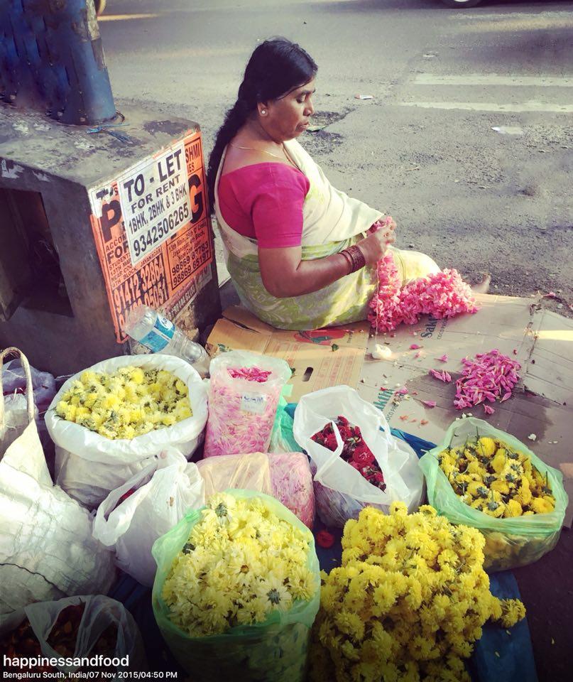 #WomenAtWork - A flower vendor