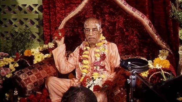 Srila-Prabhupada-on-Red-Vyassasana-Throwing-Flowers-to-Devotees