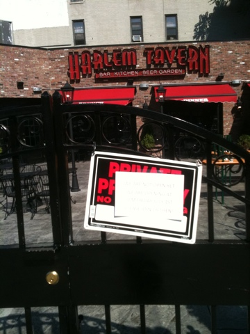 Sign says Harlem Tavern officially opening July 1