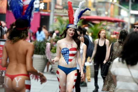 """For Sunday News: 08/26/15:Topless:New York - NY Post reporter Amber Jamieson walks in Times Square as a """"desnuda"""" as she goes undercover as a topless painted woman soliciting tips in Times Square. Photo by Helayne Seidman"""