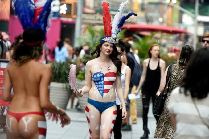"For Sunday News: 08/26/15:Topless:New York - NY Post reporter Amber Jamieson walks in Times Square as a ""desnuda"" as she goes undercover as a topless painted woman soliciting tips in Times Square. Photo by Helayne Seidman"