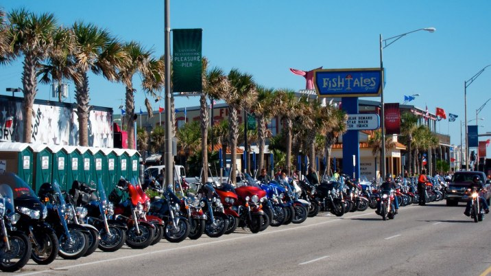 The city demands $10 to ride or park in the main festival area, downtown. Hundreds of people choose to park along the gulf shore instead.