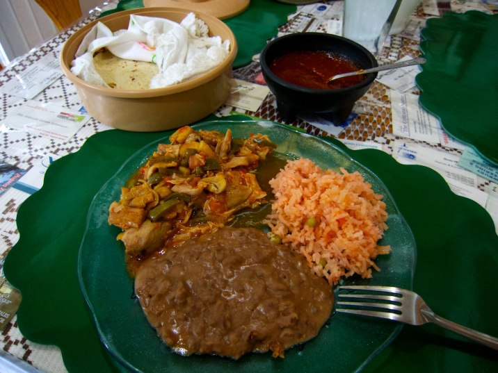Another chef's choice: chicken with mushrooms, peppers, and onions; refried beans, rice, and tortillas with salsa.