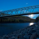 "The Stikine River is the ""Grand Canyon of British Columbia."" A very bright moon rises beneath the bridge this evening."