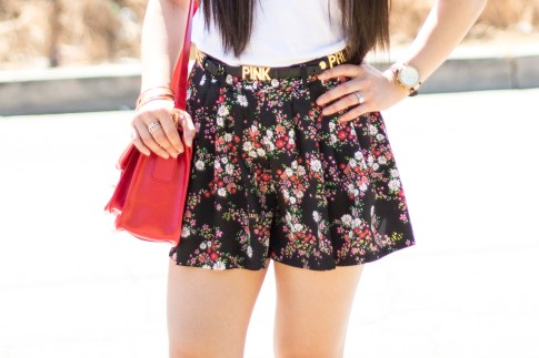 An Dyer wearing Glint & Gleam Rings, Sole Society Britt Red Satchel, BCBGeneration DIY Custom Affirmation Bracelets as a Belt, Forever 21 Floral Shorts