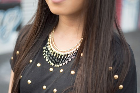 An Dyer wearing JewelMint Tribal Fringe Collar Necklace, Lovers & Friends Kiss Me Top