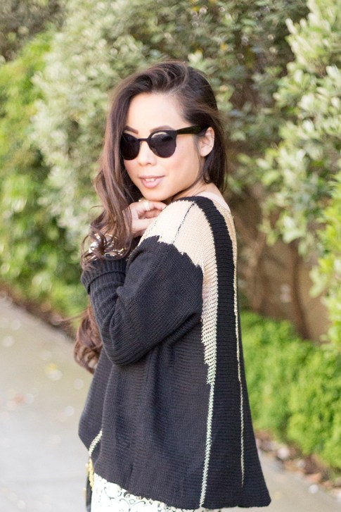 An Dyer wearing Rehab Black Sheer Mesh Sweater, Black Cat Eye Metal Sunglasses