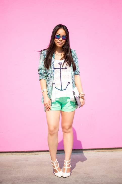 An Dyer wearing Lovers+Friends x Stylyt Bombshell Blazer, Vintage Havana Nautical Anchor Top, Allison Collection Silk Shorts, ShoeDazzle White Sahara Studded Pumps, George Gina Lucy Purple Mirrored Sunglasses, Mujjo White