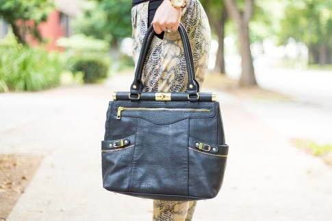 An Dyer wearing Olivia and Joy Swanky Satchel in Black, Evleo Snake Pants