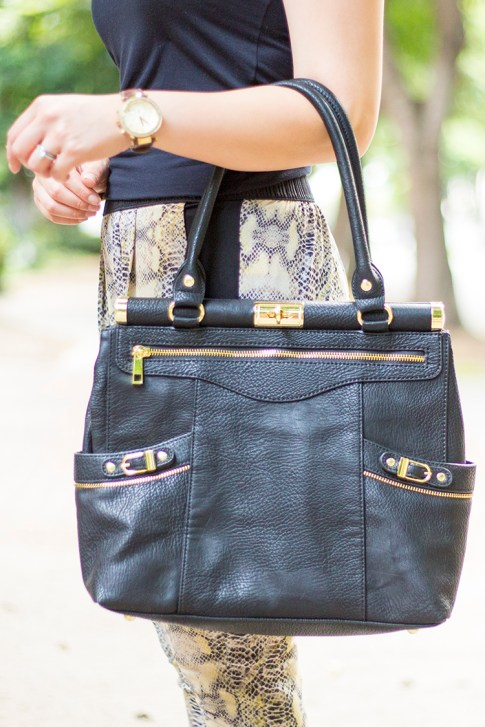 An Dyer wearing Olivia and Joy Swanky Satchel in Black