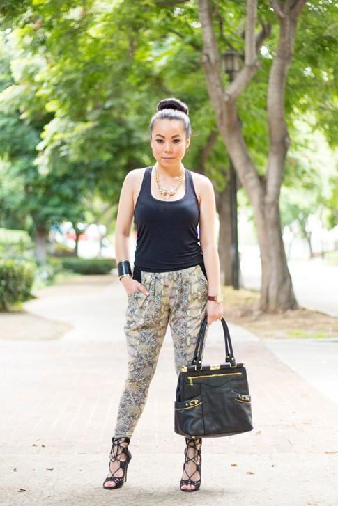 An Dyer wearing ShoeMint Romy, Evleo Baggy Snakepint Leggings, Olivia Joy Swanky Satchel, JewelMint Cobra Cuff, Jockey Rachel Zoe Tank
