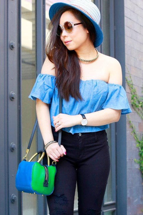 An Dyer wearing bcbg Blue Fedora with Guess denim off the shoulder top